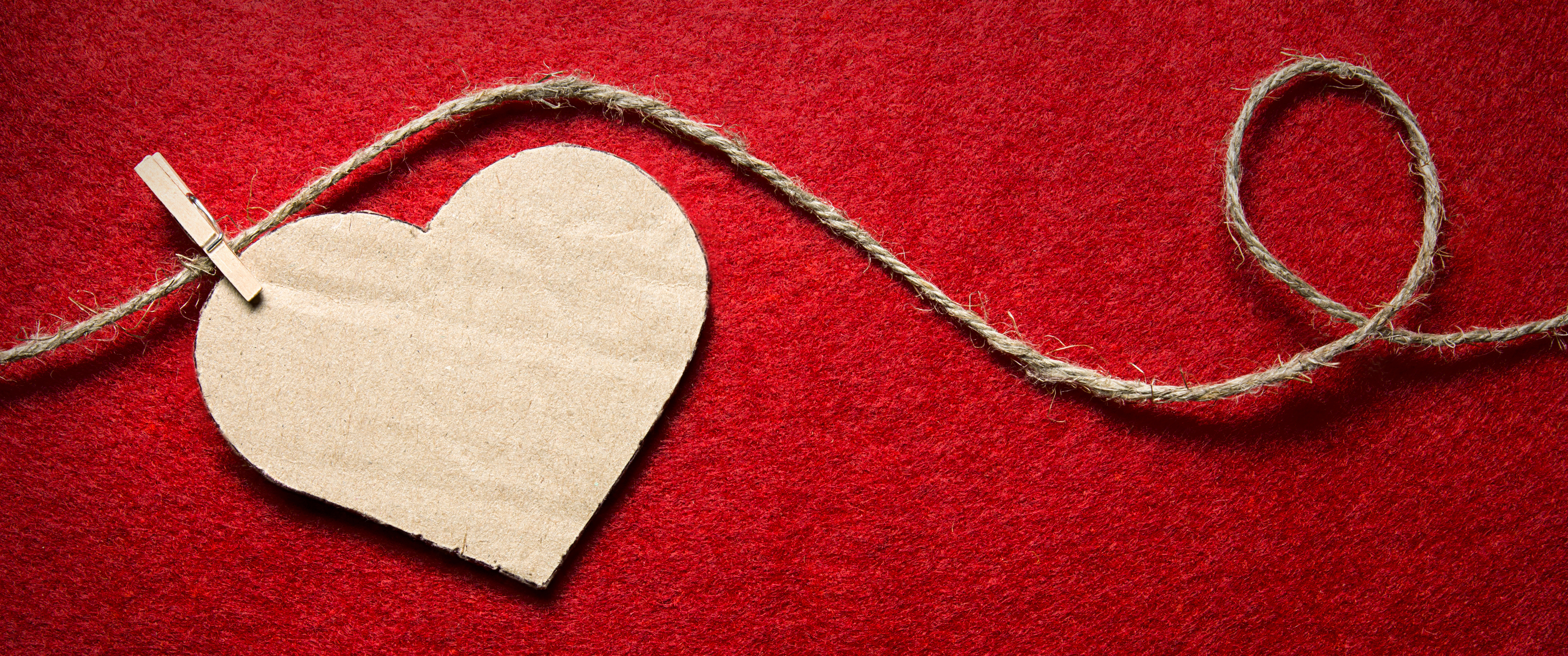 Heart From Cardboard On Rope With Clothespin On Red