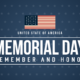 a U.S. flag with Memorial Day Remember and Honor on a dark blue background