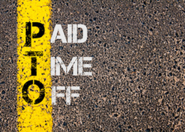 Business Acronym PTO - Paid Time Off. Yellow paint line on the road against asphalt background. Conceptual image