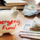 Emergency fund written on a piggy bank.