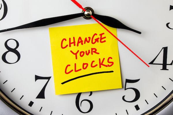change your clocks on post-it stuck to a wall clock