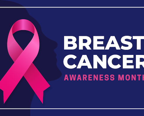 breast cancer awareness pink ribbon on a dark blue background