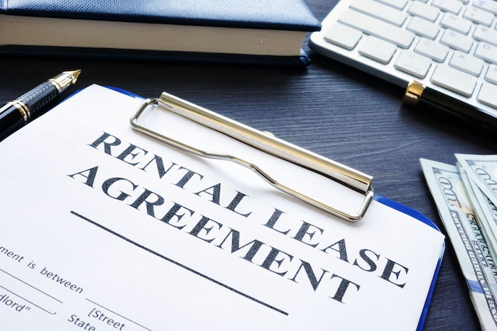 Rental lease agreement with pen on a desk.