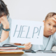 Learning difficulties, remote education, online learning concept. Tired mother and sad kid need help to do homework at home