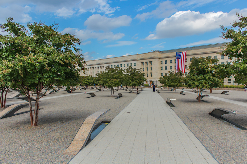 the Pentagon Memorial, looking down the path toward the building, with memorial benches off to each side